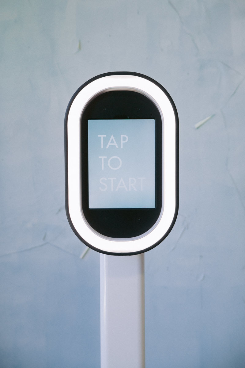 A photobooth that says tap to start.