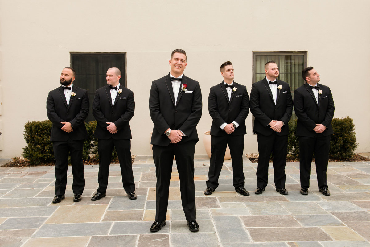 Groom and groomsmen outside The Inn at Fox Hollow