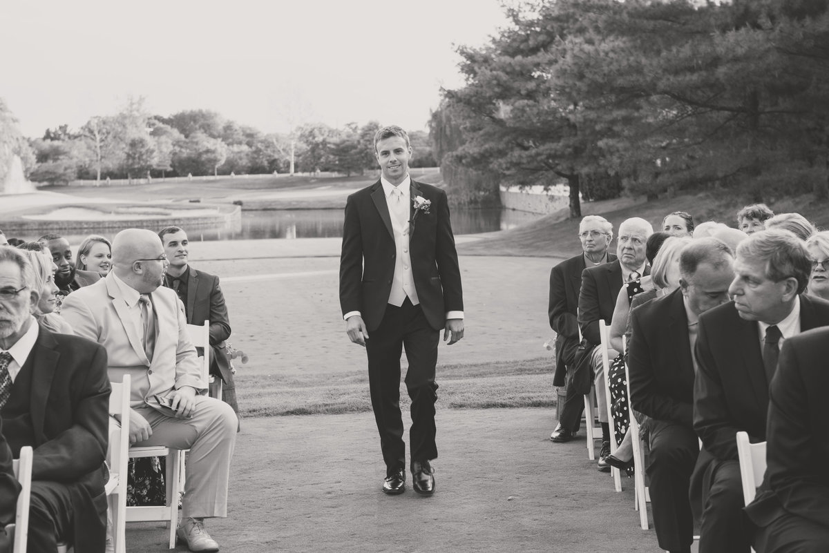 black and white groom walking down the aisle wedding photo at Willow Creek Golf and Country Club