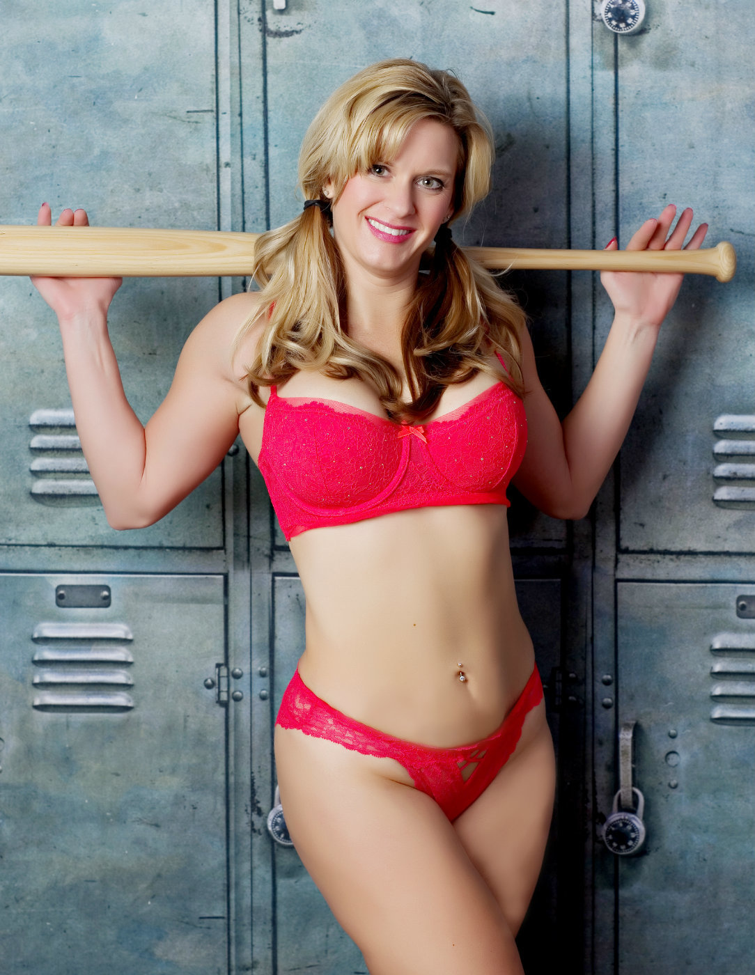 sports boudoir image showing a woman with a baseball bat