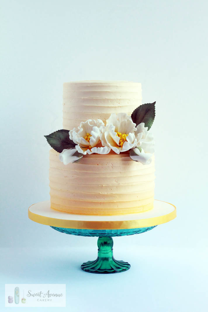 yellow ombre striped buttercream cake with flowers, wedding cakes Burlington