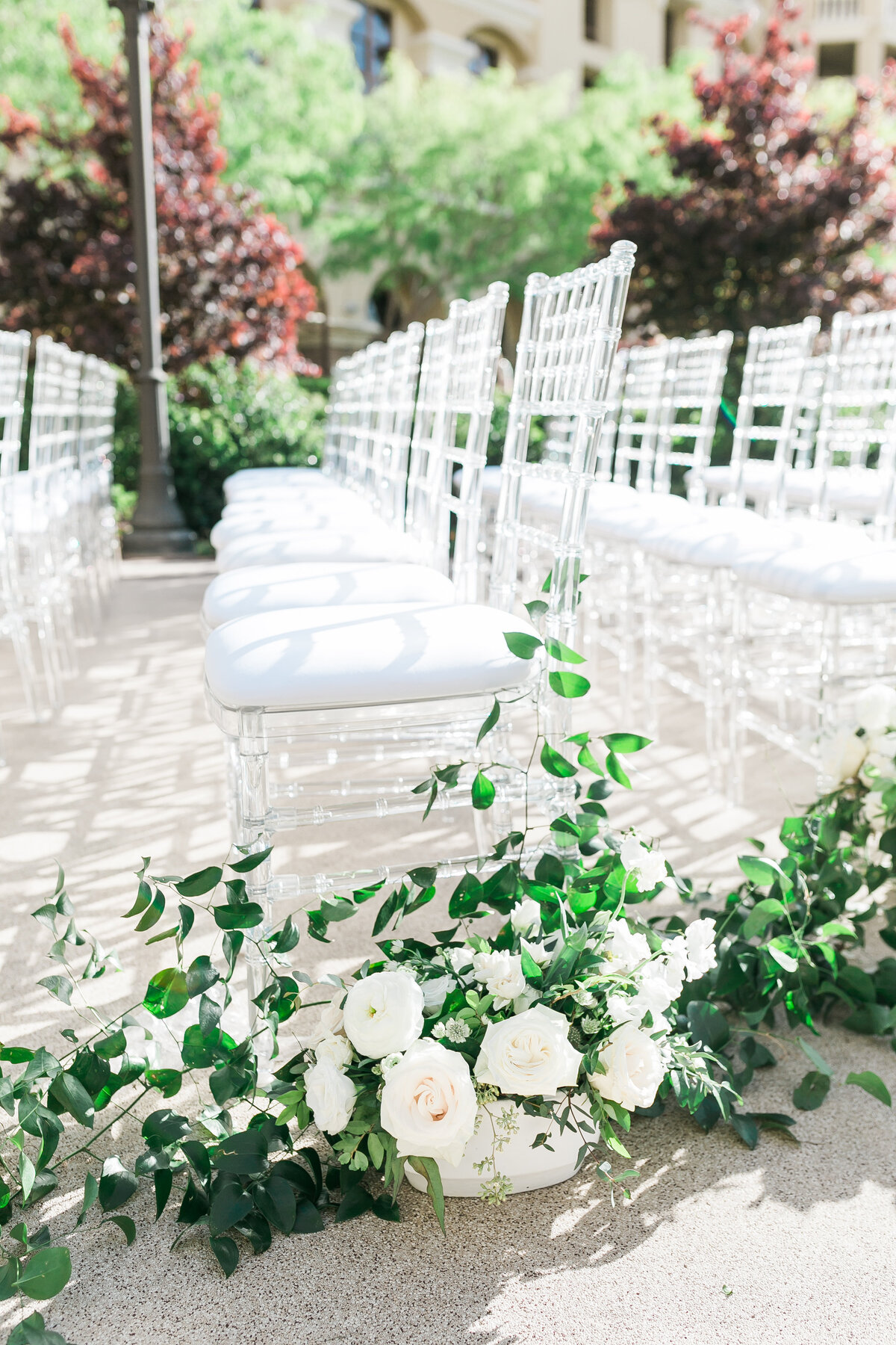 wedding-ceremony-ghost-chairs