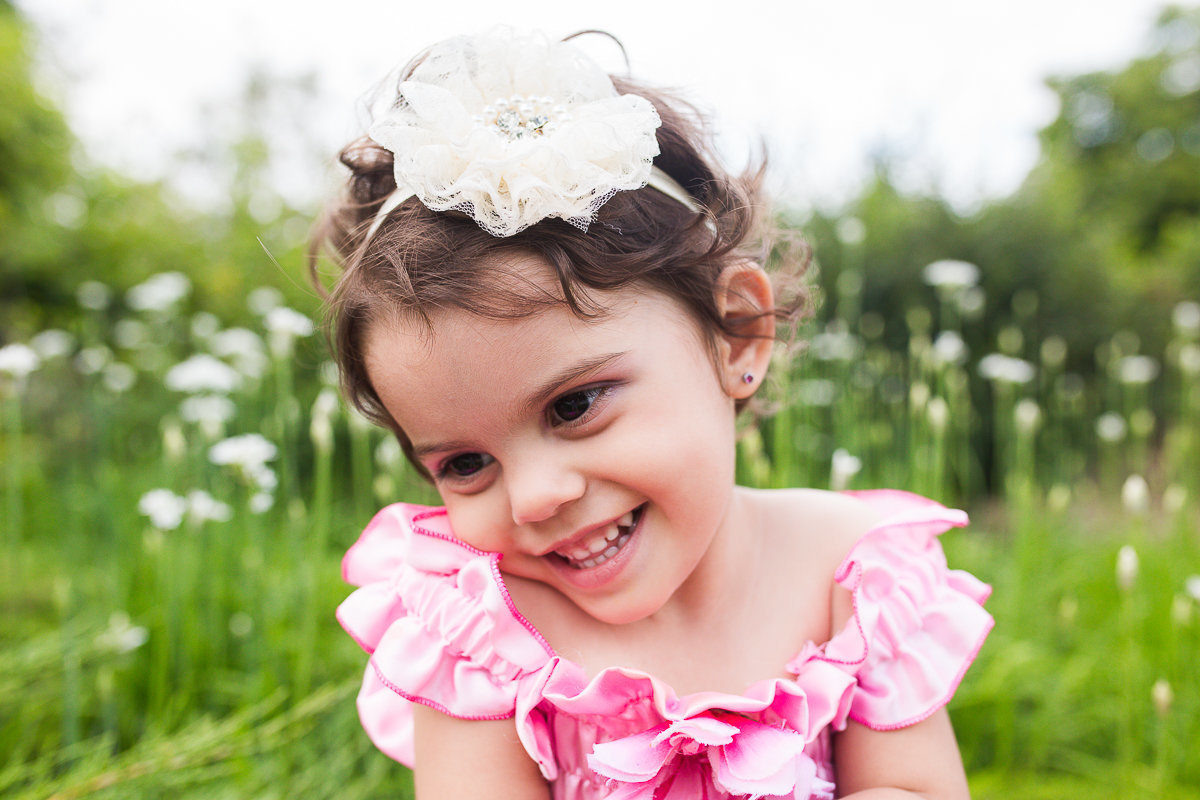 two year old girl looking shyly away from camera {Mississauga Child Photographer}