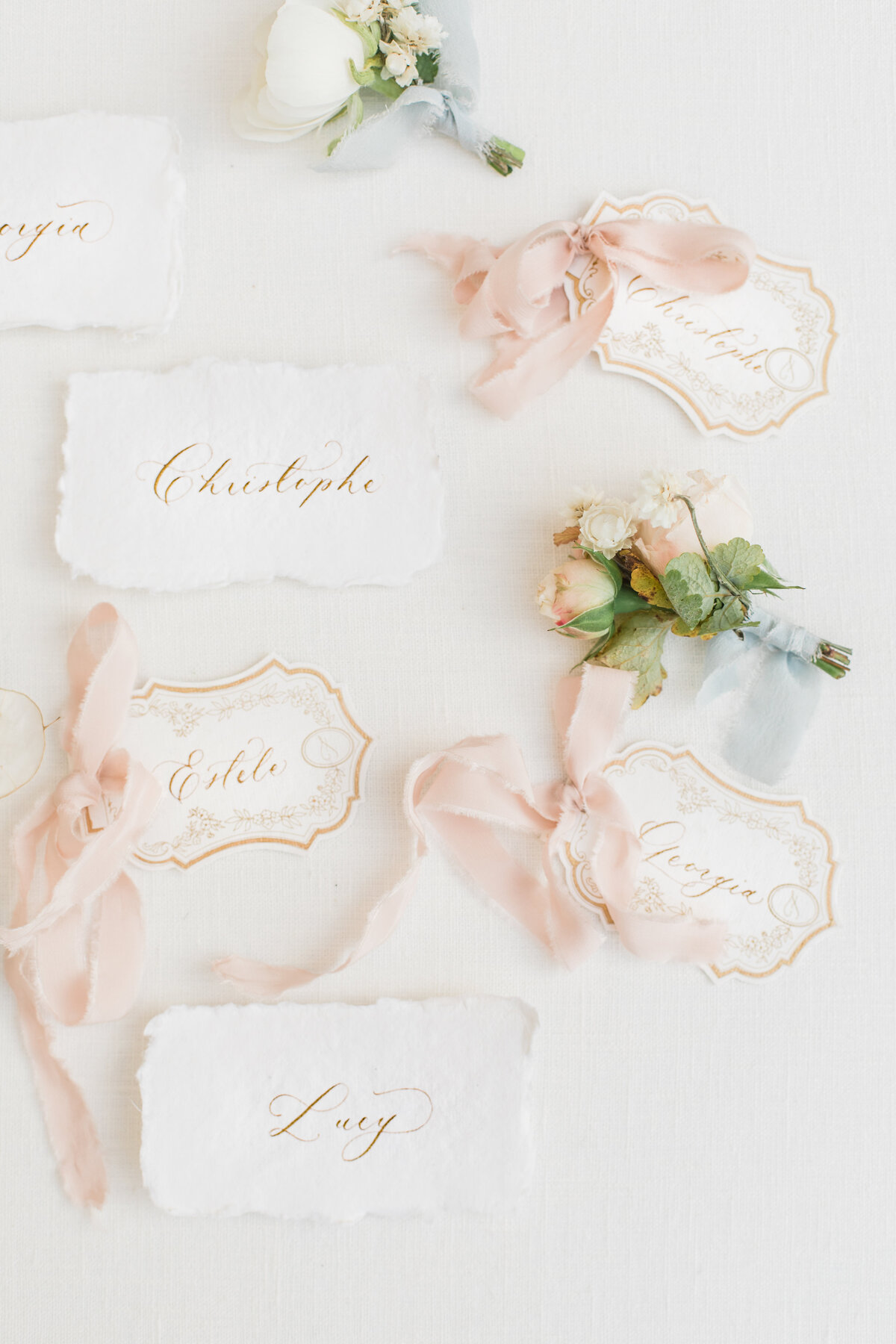 name place cards with gold calligraphy at champagne france wedding by costola photography