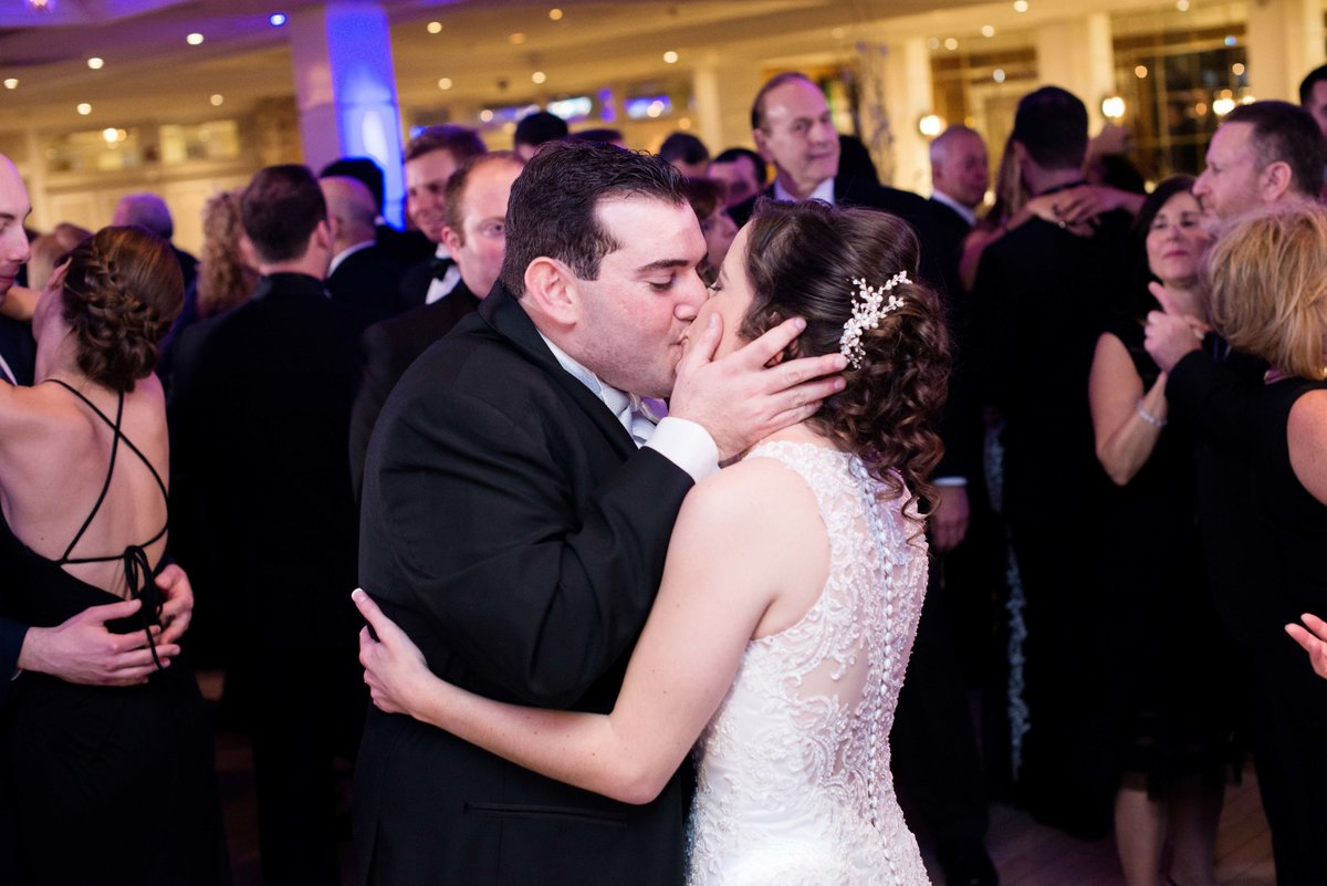 Bride and groom kissing on the dancefloor at Watermill Caterers