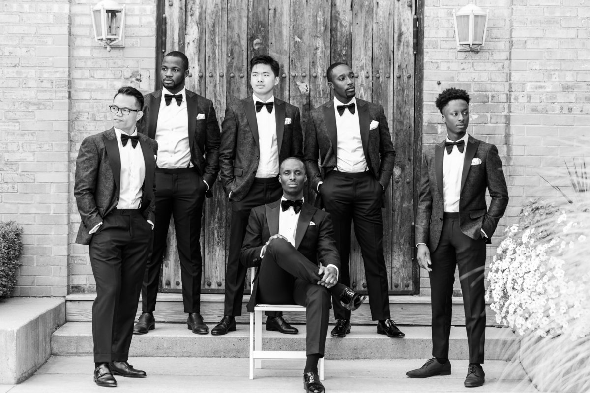 black and white wedding photo of grooms men