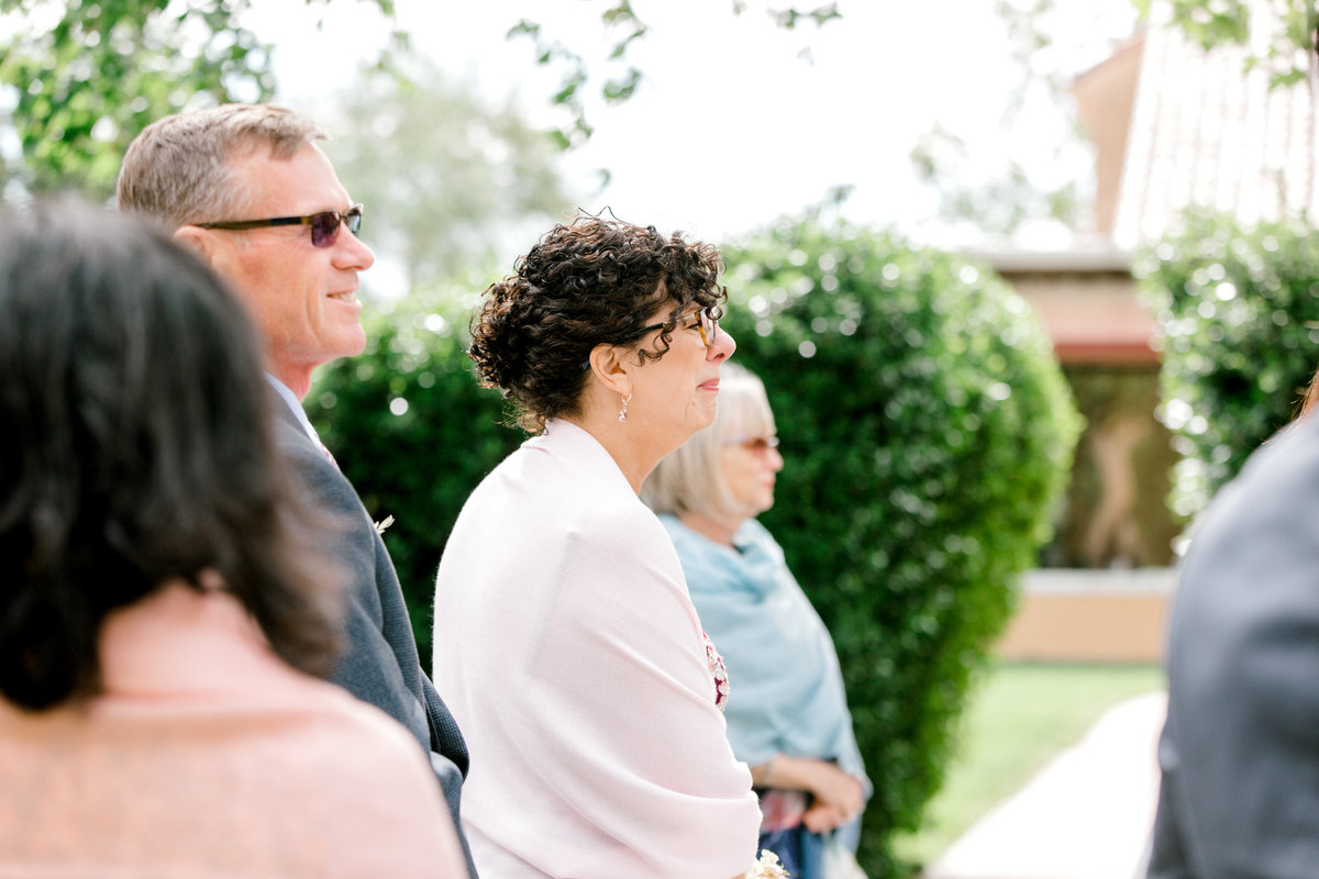 Mother of the bride crying as she watches her daughter walk down the aisle at Vintners Inn in Santa Rosa California