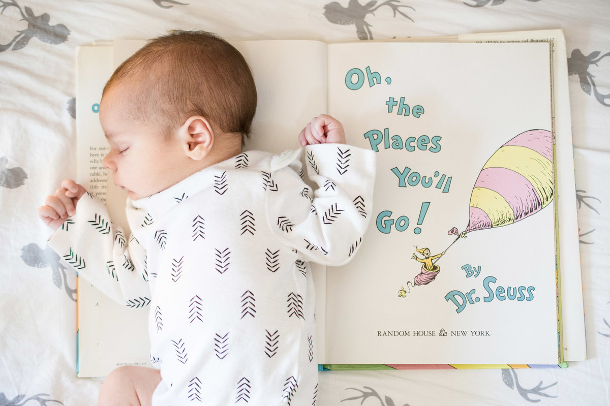 Baby sleeping on Dr. Seuss book