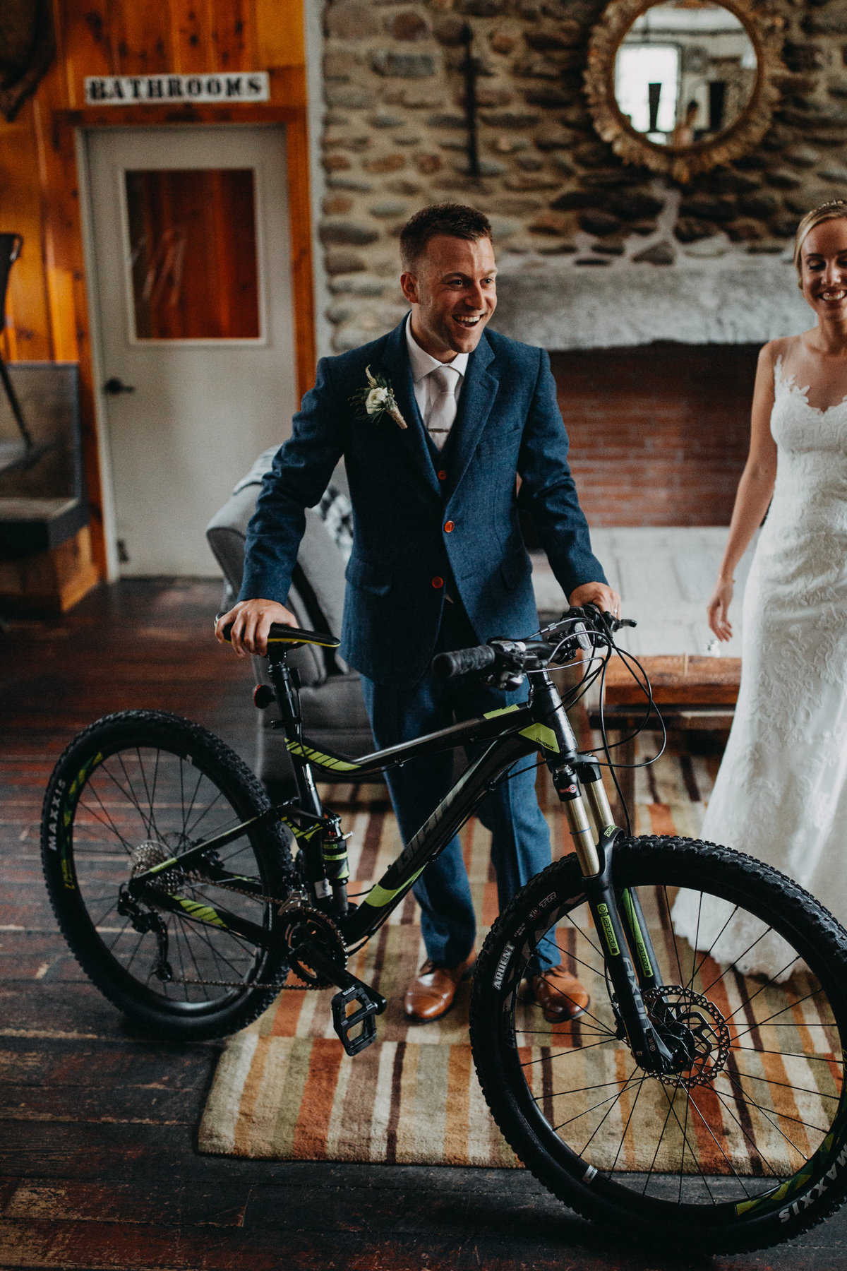 Groom posing with bike present from wife