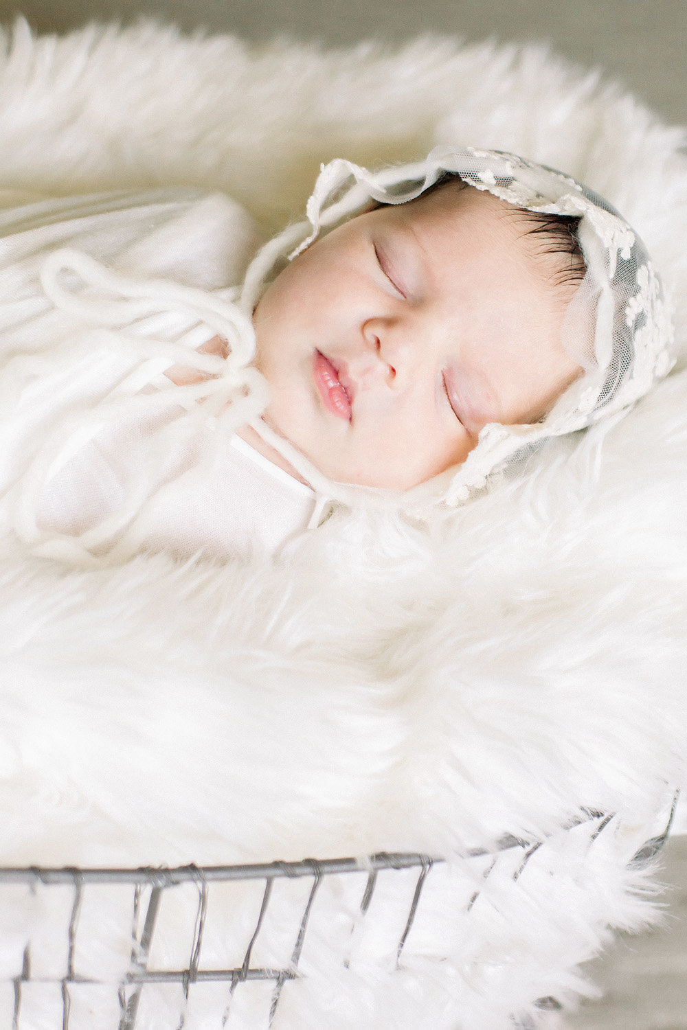 baby in lace bonnet