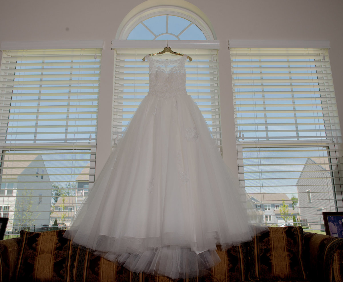 Wedding Dress Hanging by the Window Potomac maryland