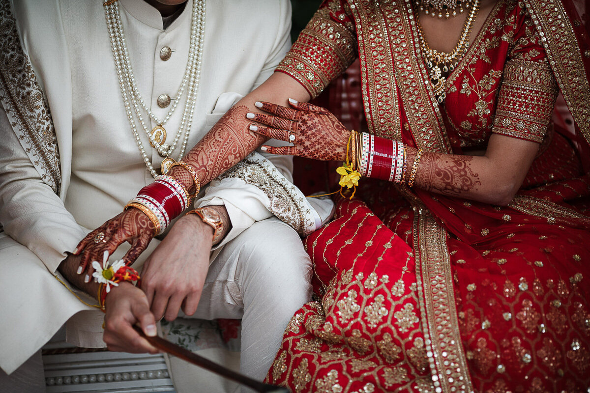 detail shot of Indian couple's hands during their ceremony at the Coral Gables country club