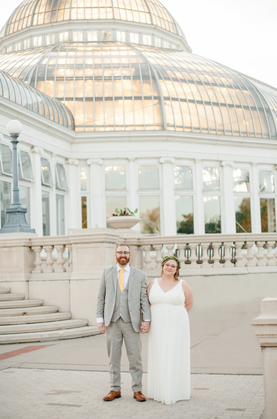 wedding couple stands outside como zoo conservatory in st paul minnesota elopement