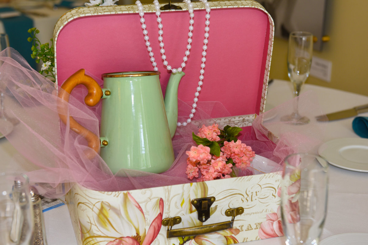 National Museum of Dance, Saratoga Springs, NY, vintage floral travel suitcase, pink tulle, strands of pearls, mint green ceramic coffee pot