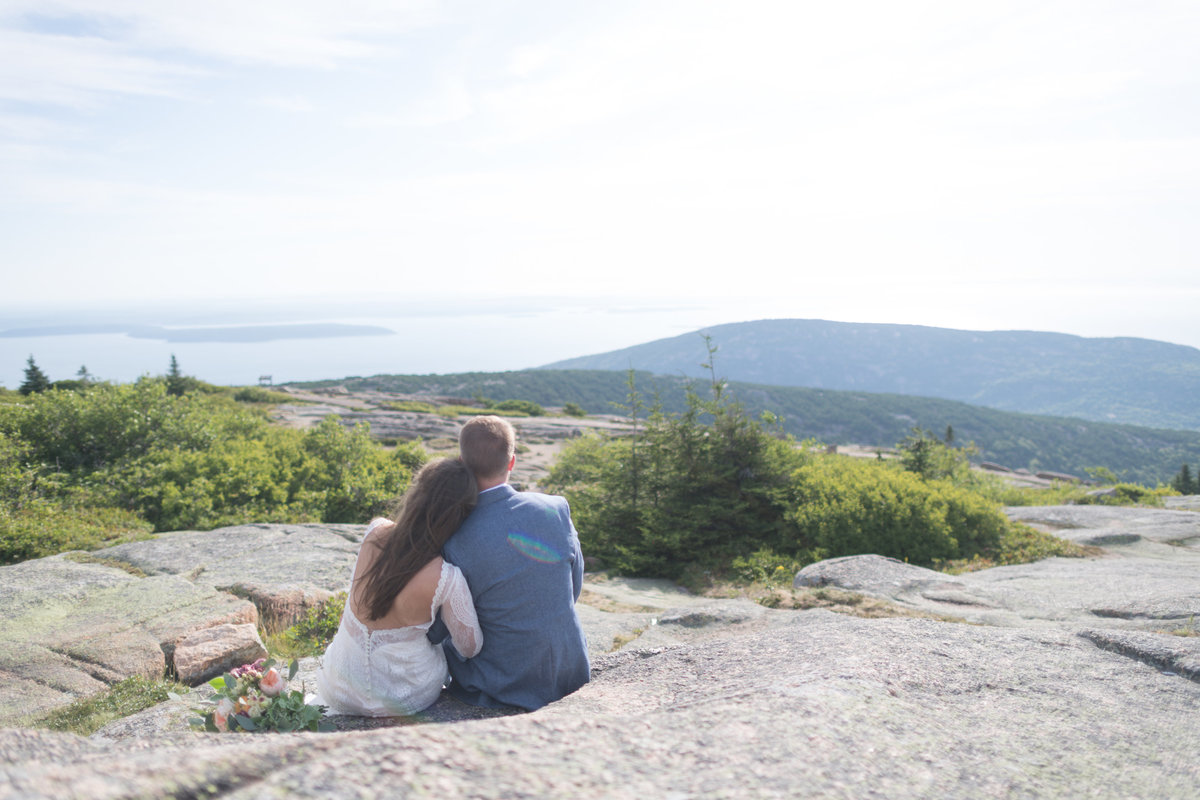 Couple enjoying the view of Acadia National Park during their adventure session
