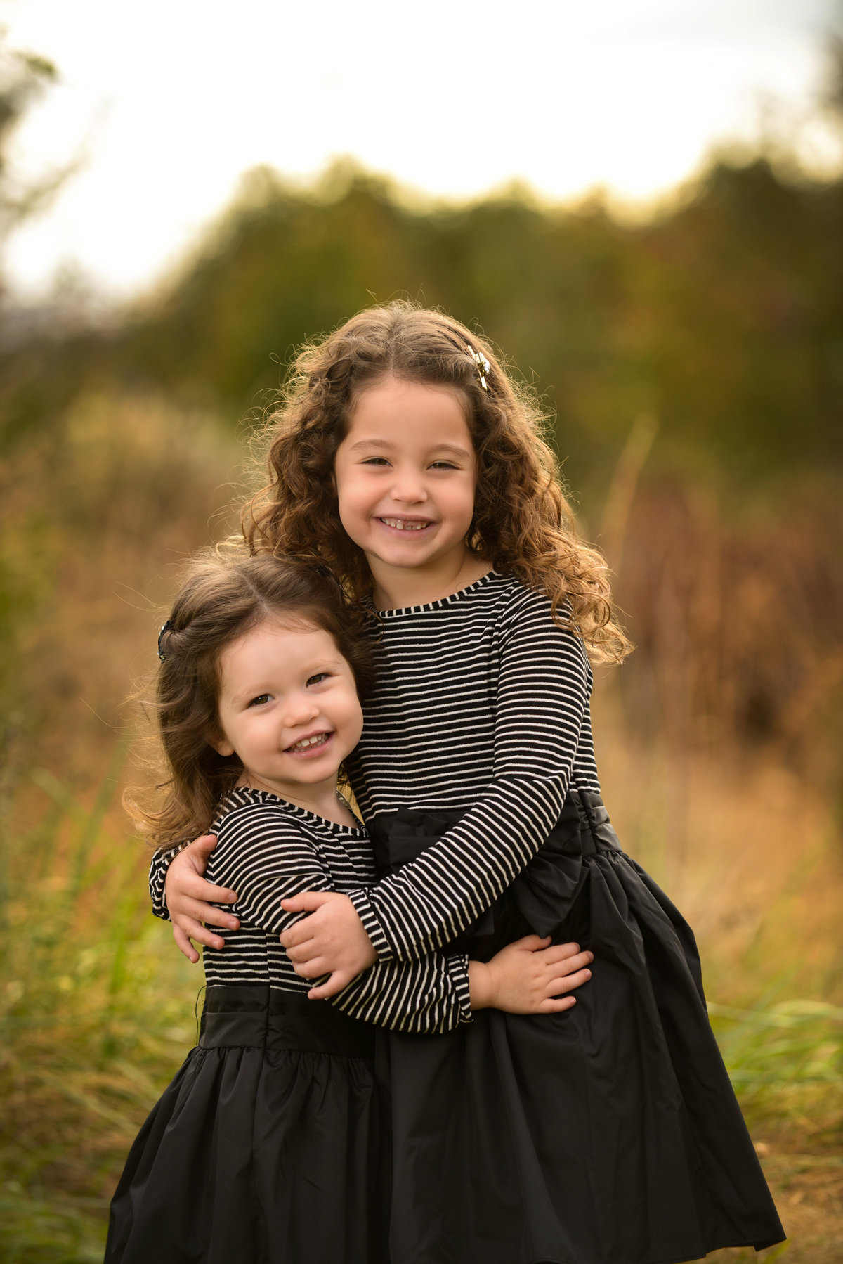 Sweet sisters during their family photo shoot in Baltimore, MD