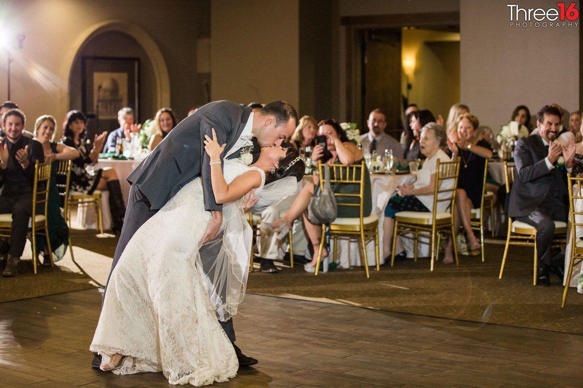 A dip and a kiss from the Groom to his Bride on the dance floor