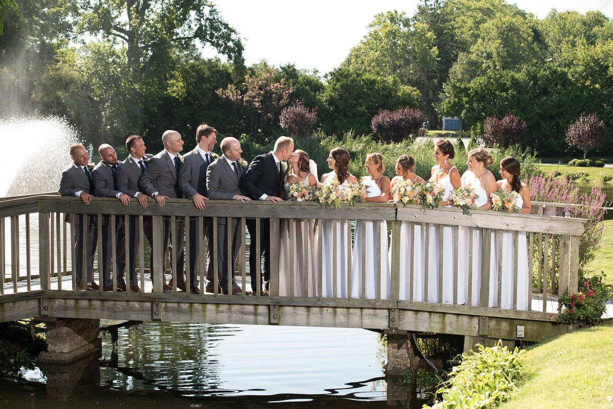Bridal party on the bridge outside at Flowerfield
