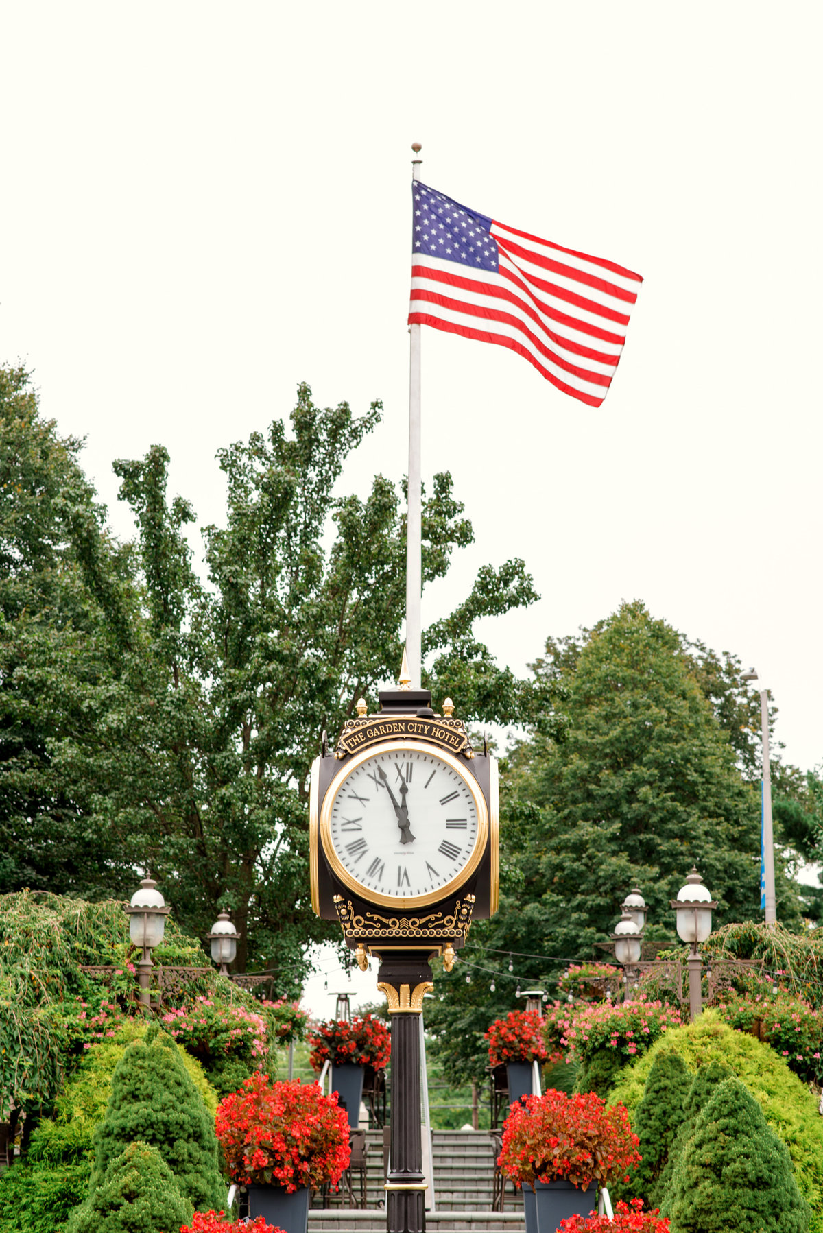 photo of the clock and American flag from outdoors at The Garden City Hotel