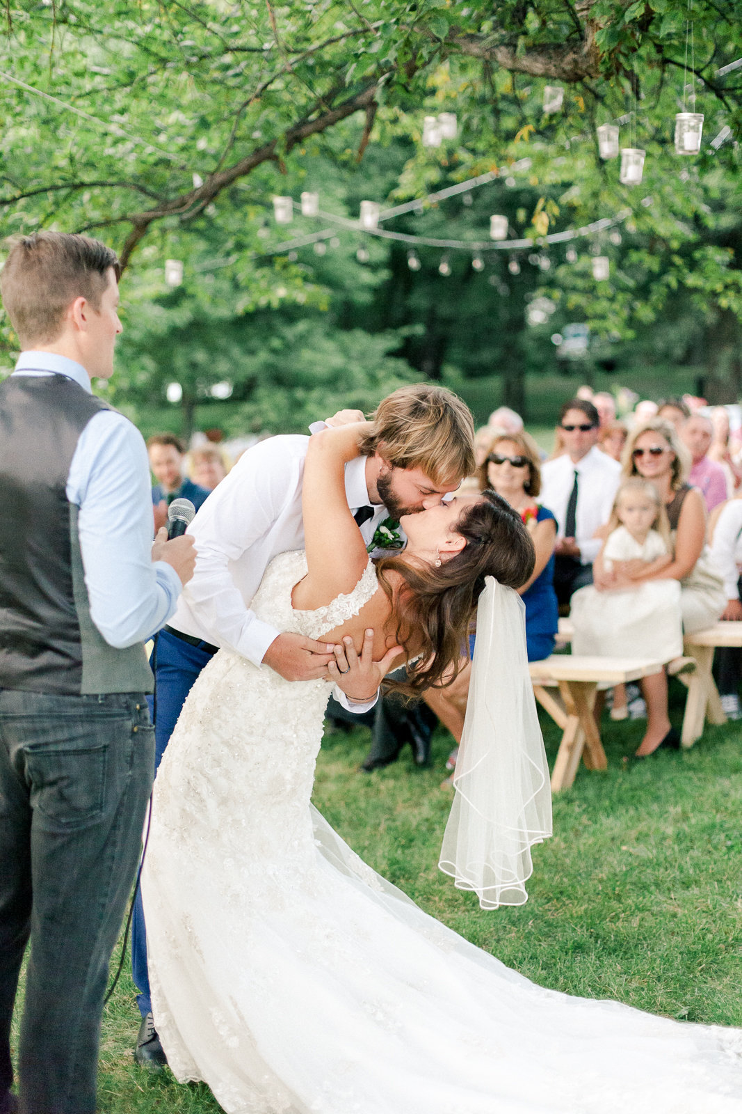 backyard wedding ceremony minnesota first kiss from bride and groom