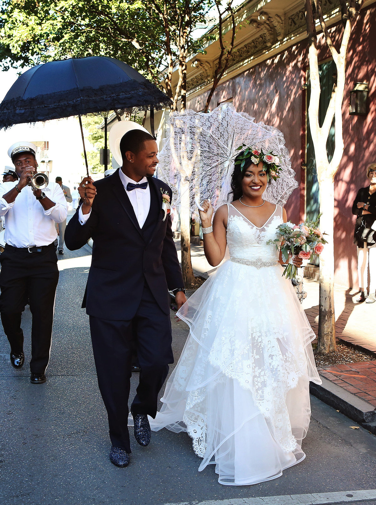 groom looks lovingly at his bride during second line parade