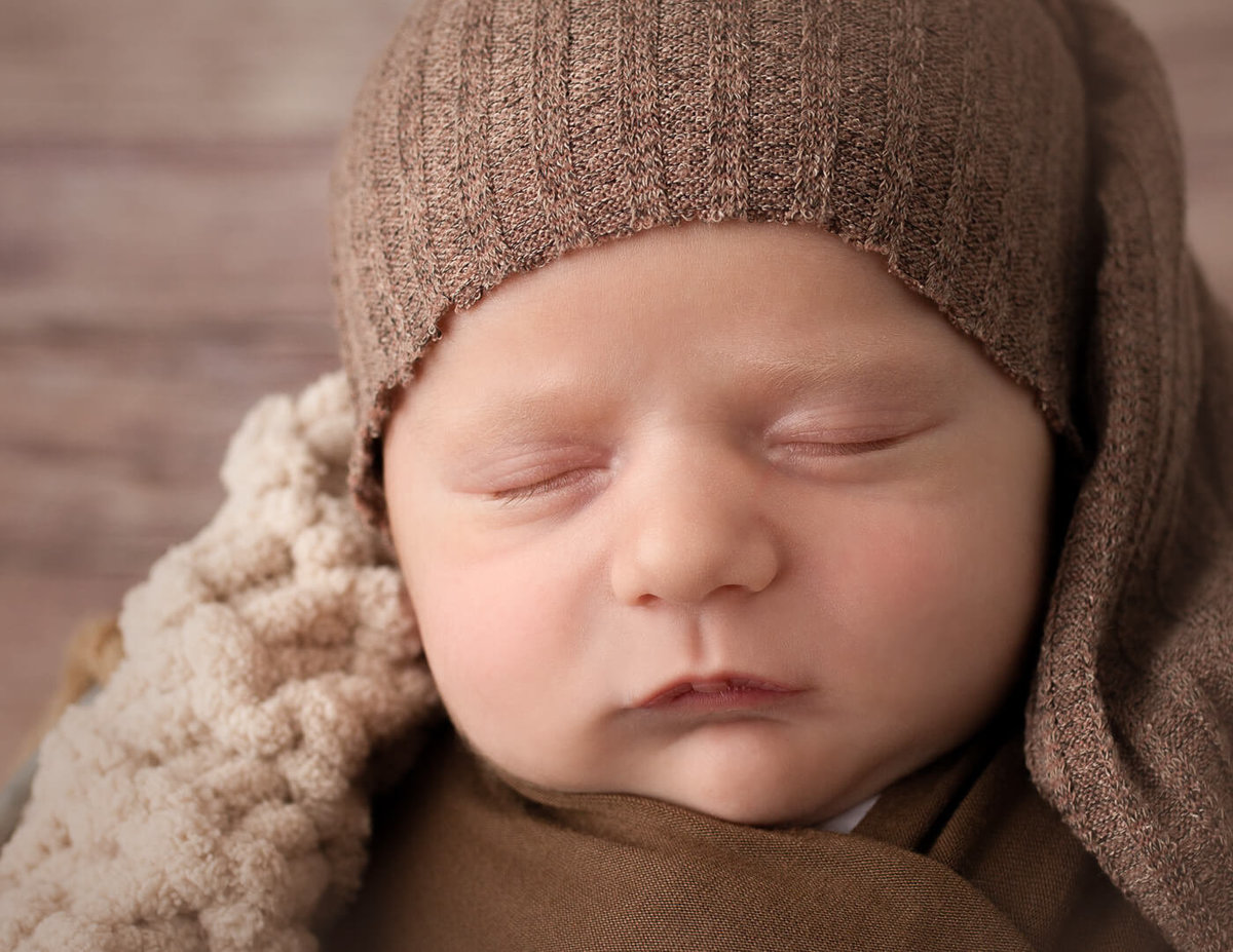 Close-up of a newborn boy in our Rochester, NY studio.