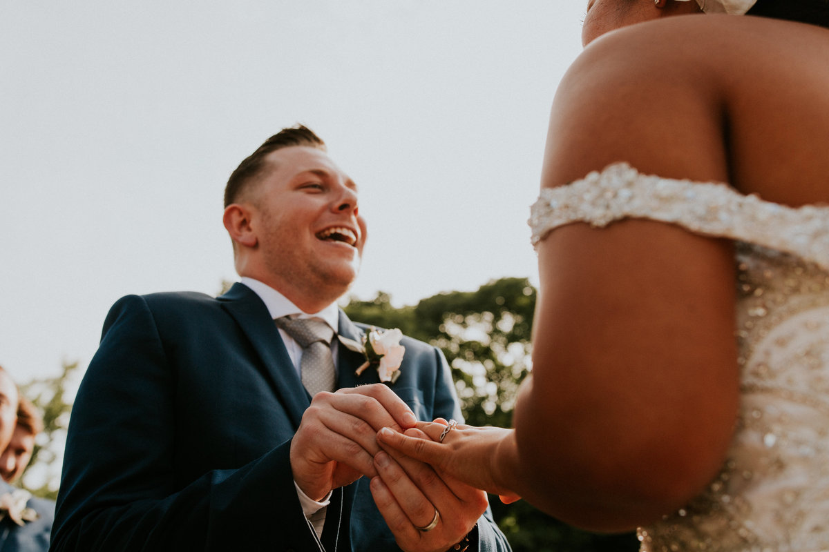 Summer wedding  at the grange insurance audubon center in columbus ohio. An emotional ring exchange from a unique perspective