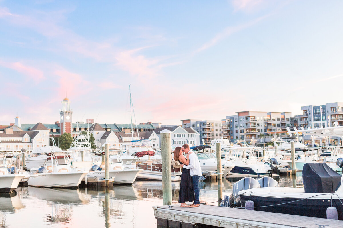 couple kissing in boatyard in Boston at sunset