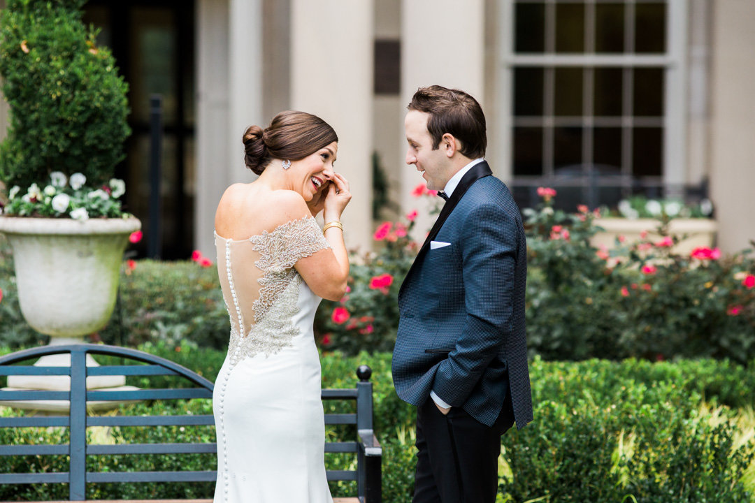 A bride is moved to tears after the first look with her groom at the Biltmore Ballrooms in Atlanta