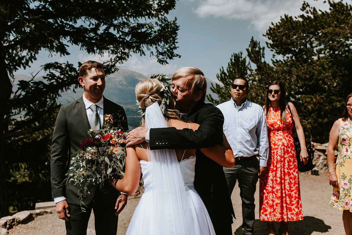 father giving bride a hug before wedding ceremony at Sapphire Point in Dillon Colorado