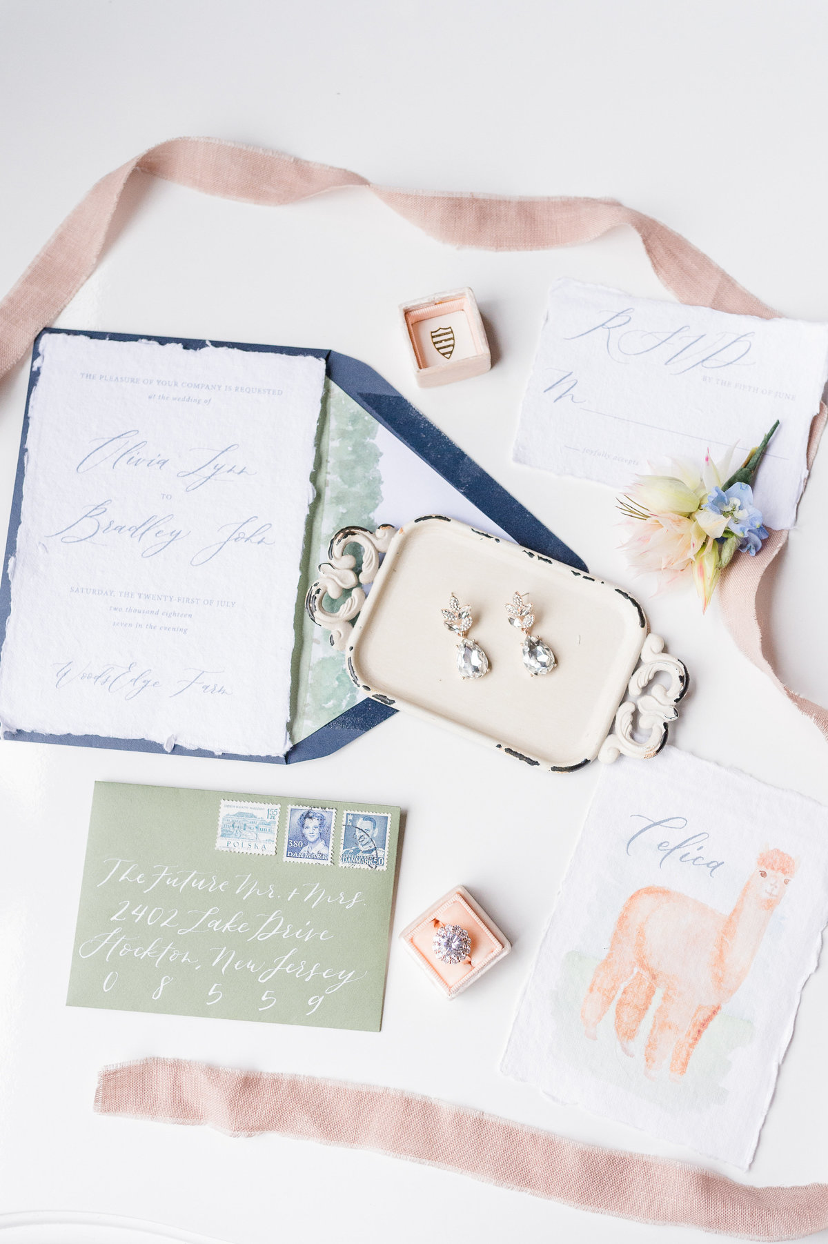 Flatlay of custom wedding stationery