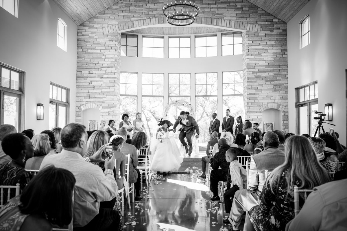 canyonwood ridge wedding photographer black couple jump the broom 250 S Canyonwood Dr, Dripping Springs, TX 78620