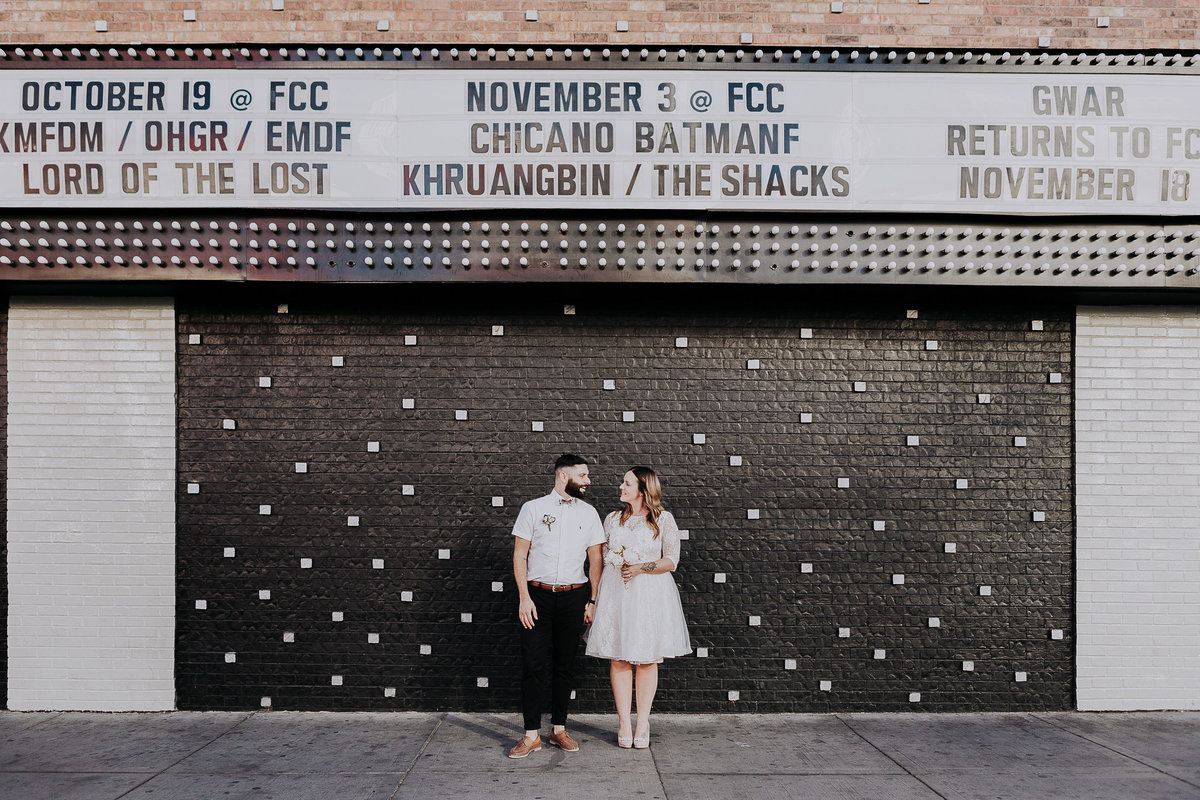 Lake Tahoe wedding photos couple poses in front of marquee