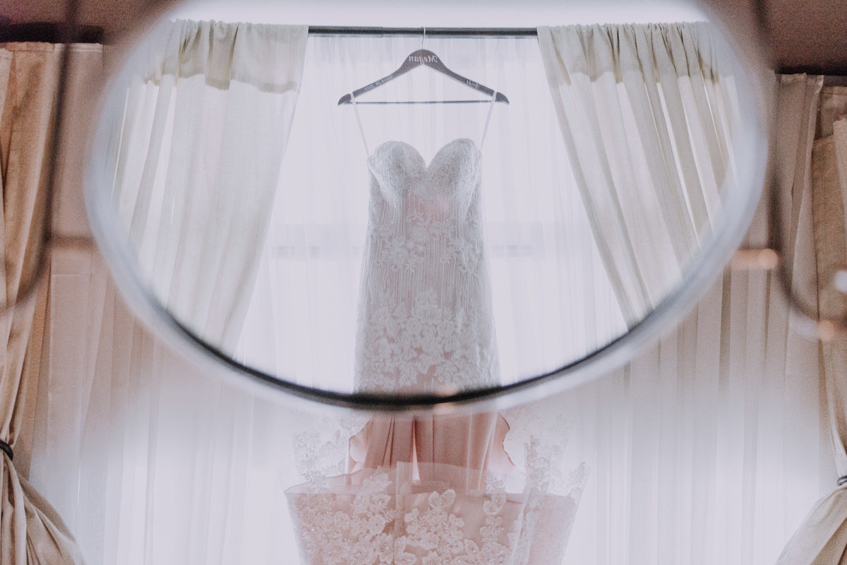 reno wedding photographers bride's dress hanging in window