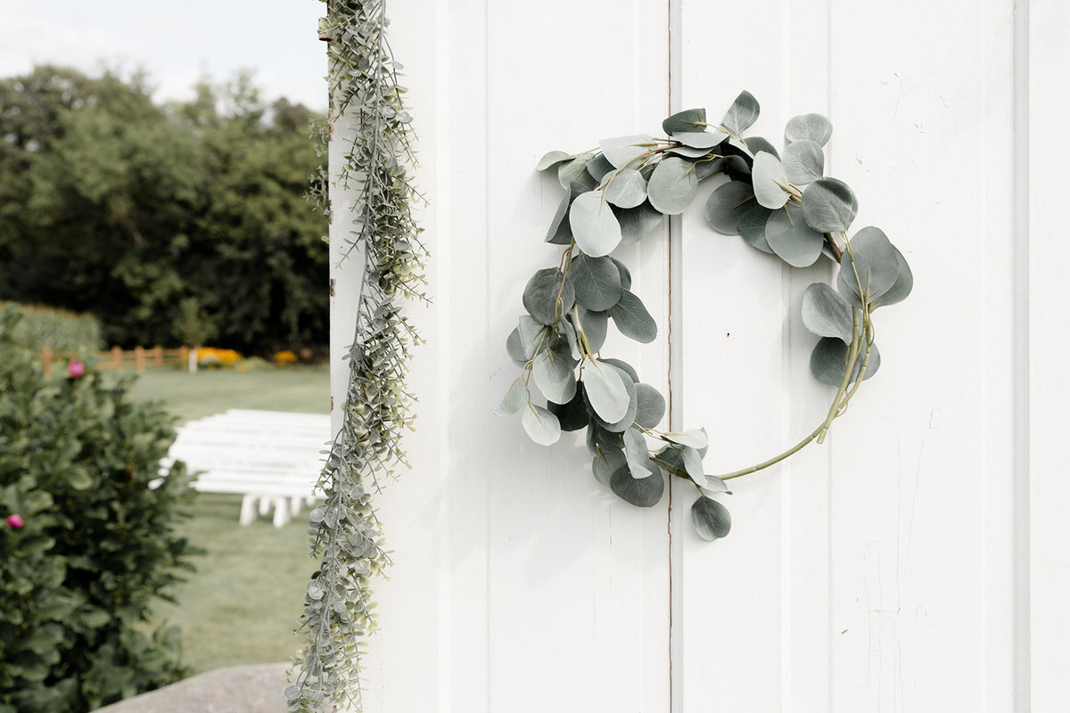 Eucalyptus Ring  Wedding Decoration on White Barn Door