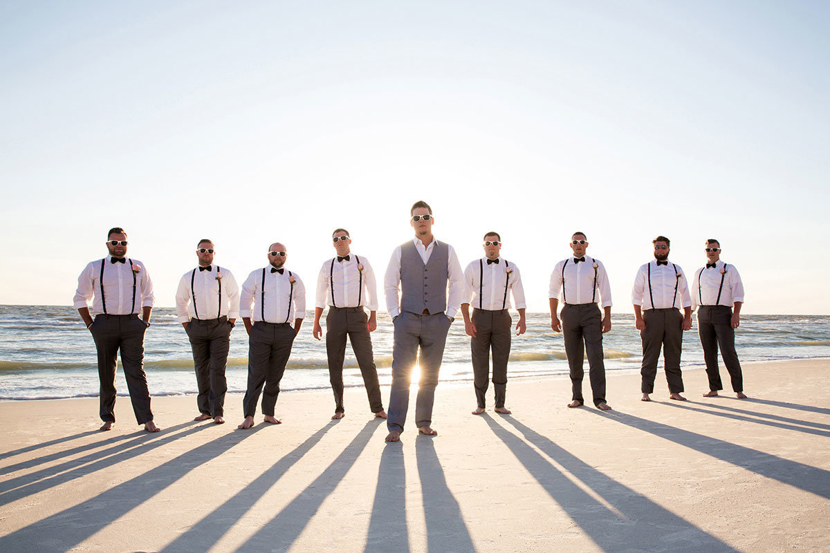 groomsmen on beach laplaya naples wedding