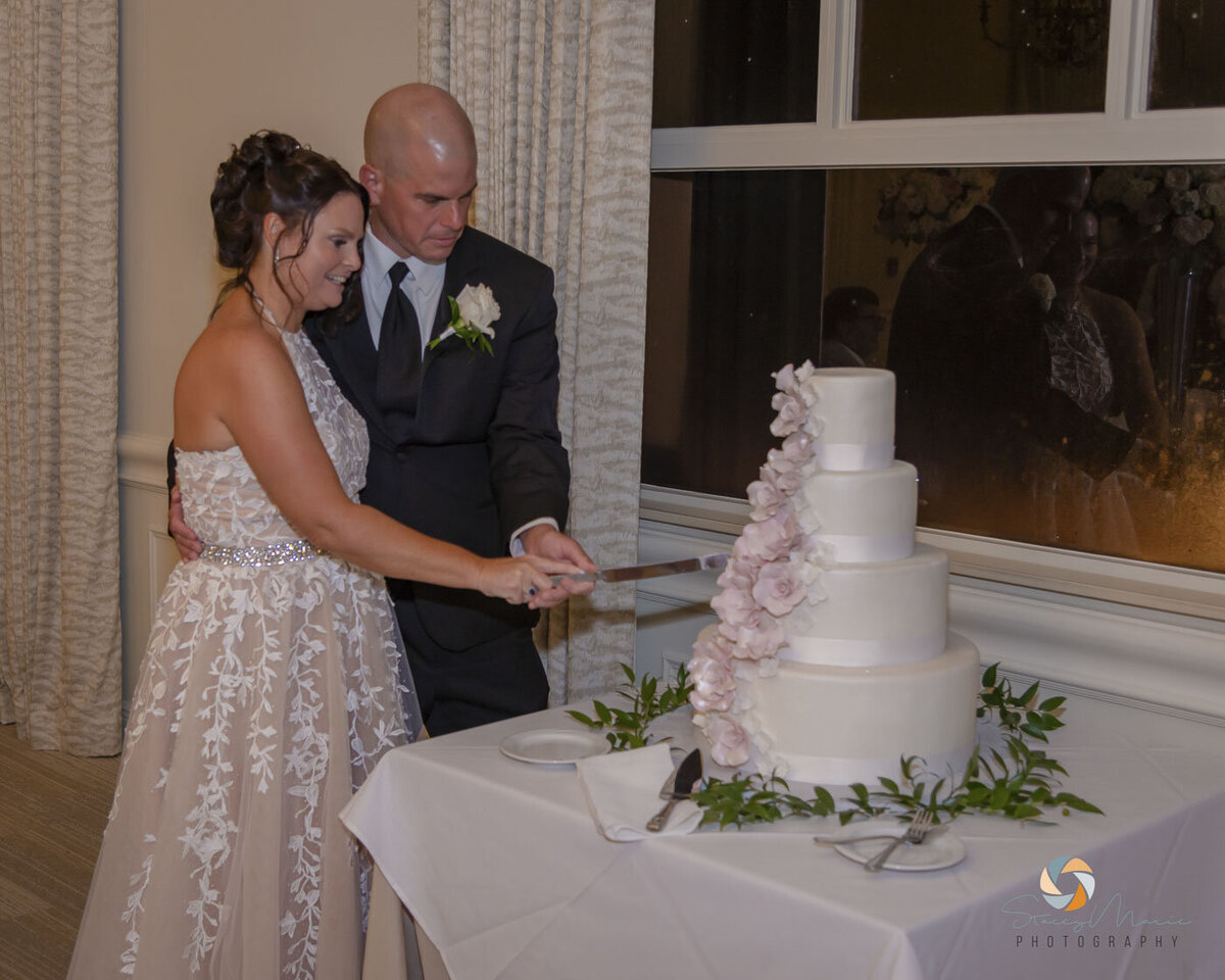 Couple cuts the cake at their wedding
