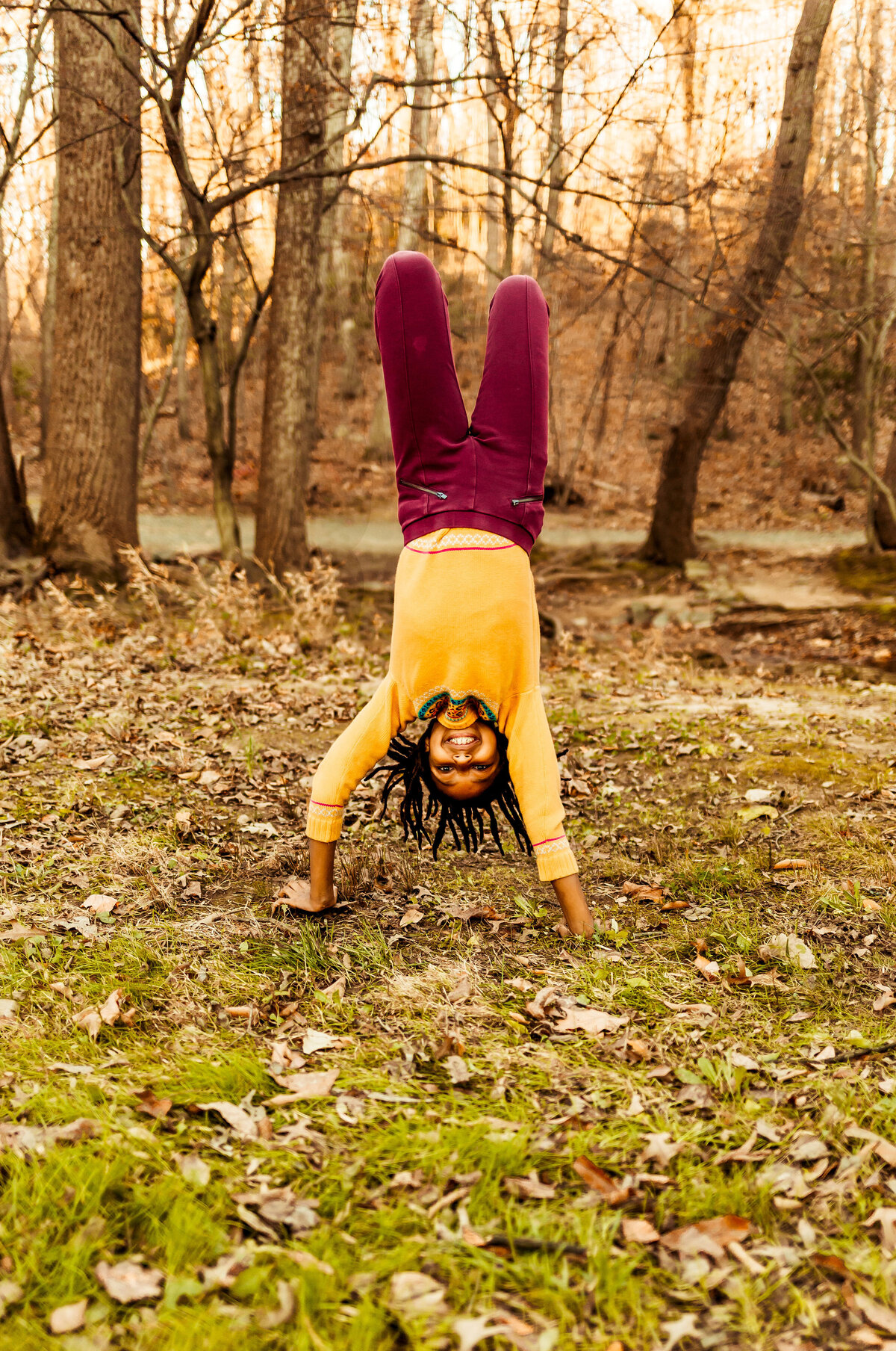 Girl doing handstand in the woods