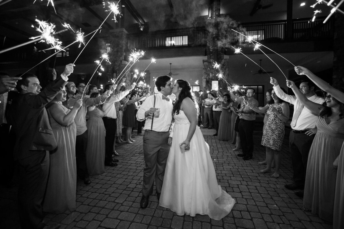 bride and groom kiss during wedding sparkler exit Atlanta