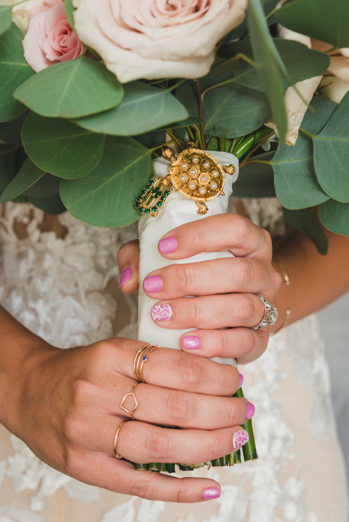 up close of brides hands holding bouquet from wedding at Pavilion at Sunken Meadow