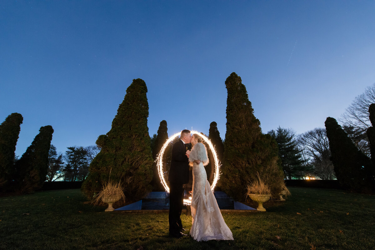 night shot of bride and groom kissing outside from wedding at The Carltun
