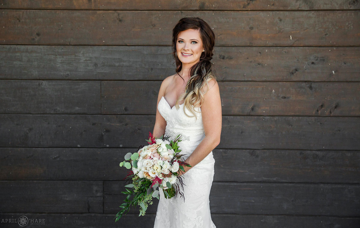 Classic bridal portrait on the wood deck at Frost Eagle Golf Club in the Colorado mountains