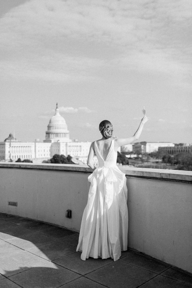 bride-cheers-champagne-us-capitol-101-constitution-dc-liz-fogarty