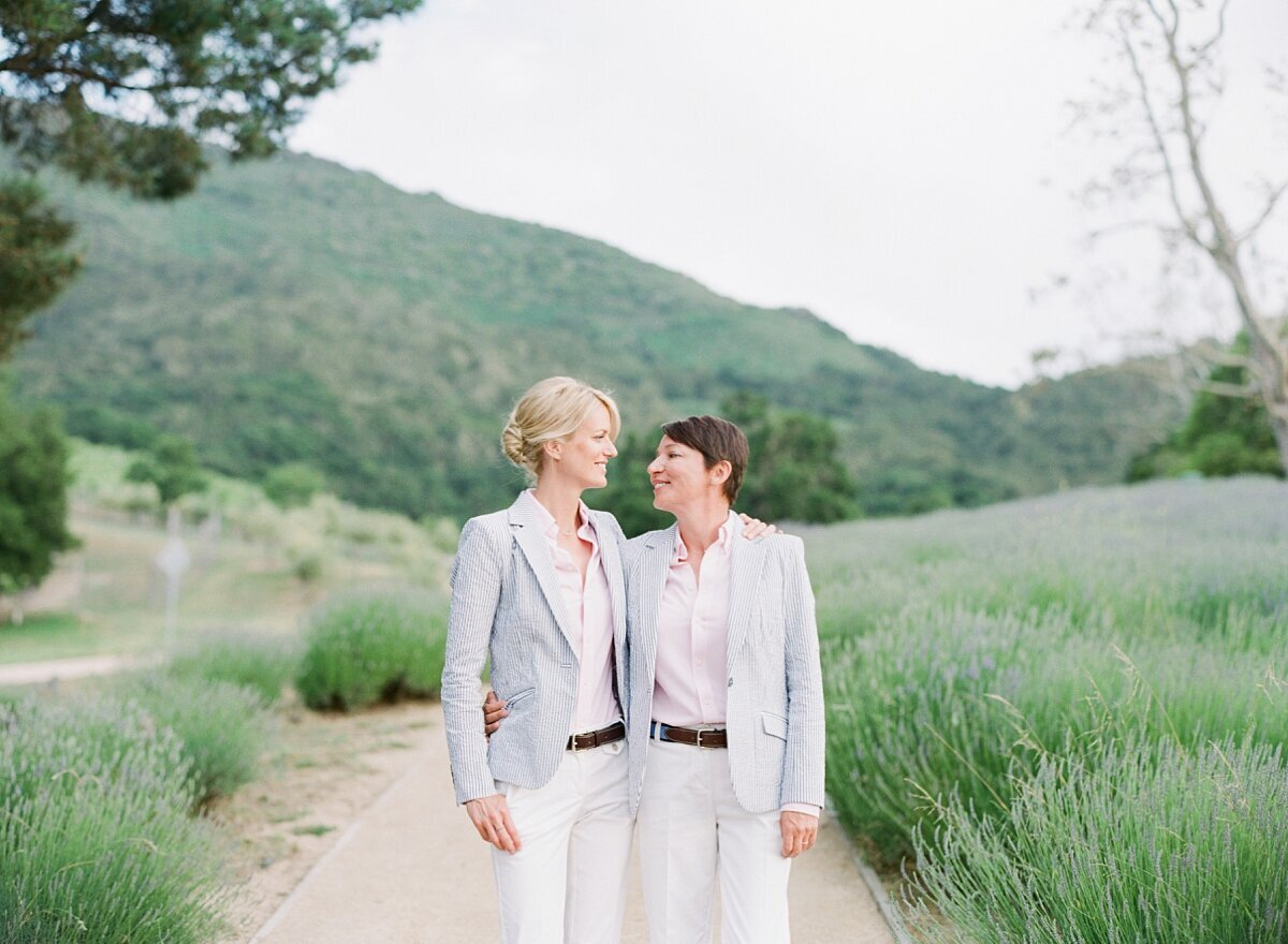 LGBT couple smiles for their Carmel engagement photos