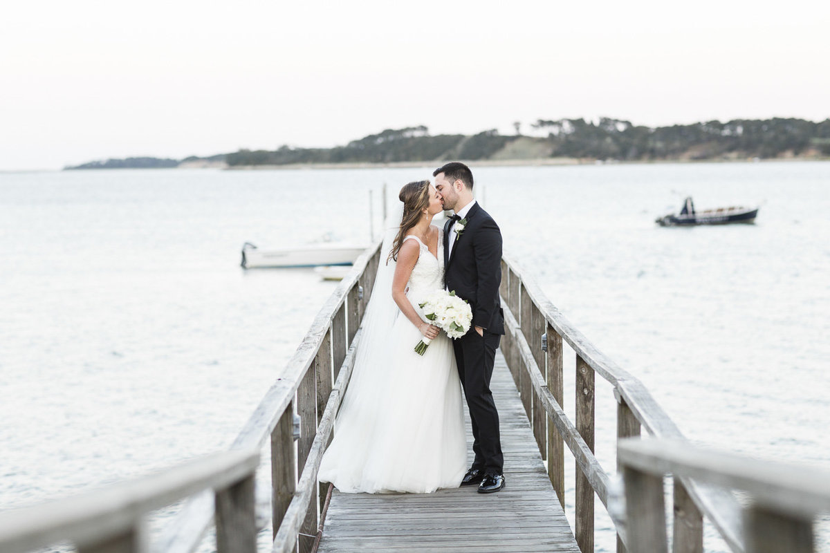 Couple kissing on a dock at Wequassett Resort and Spa