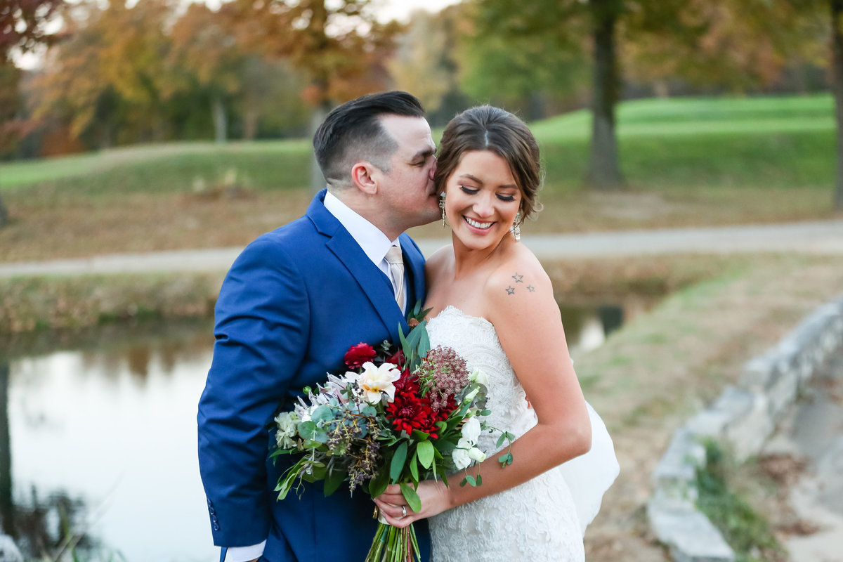 Romantic Fall Elopement  bride and groom in blue suit at Fox Run Golf Club in St. Louis  by Amy Britton Photography Photographer in St. Louis