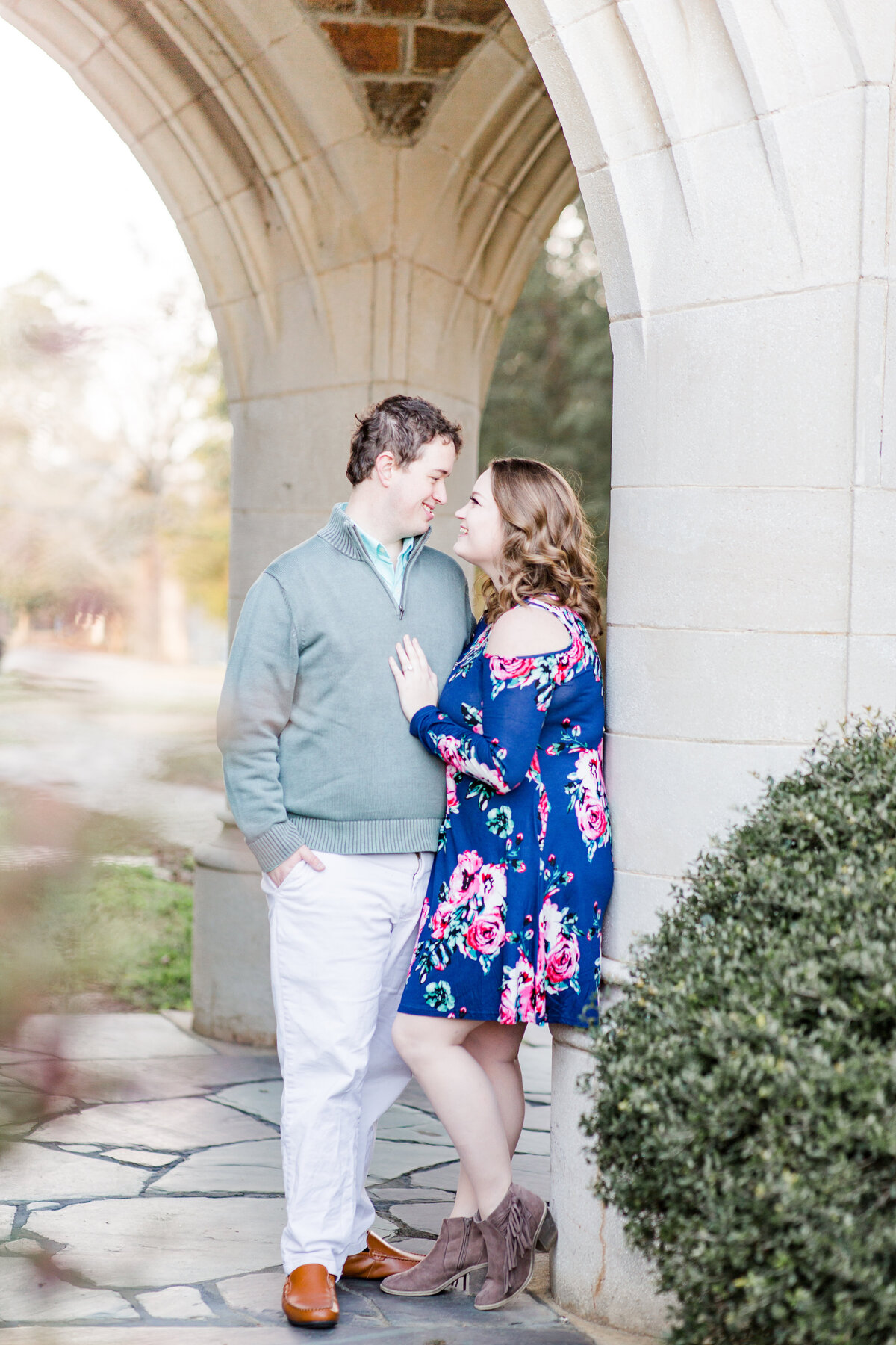 A couple at Berry College in Rome Georgia for light and airy engagement portraits session by Jennifer Marie Studios, top Atlanta Georgia wedding photographer.