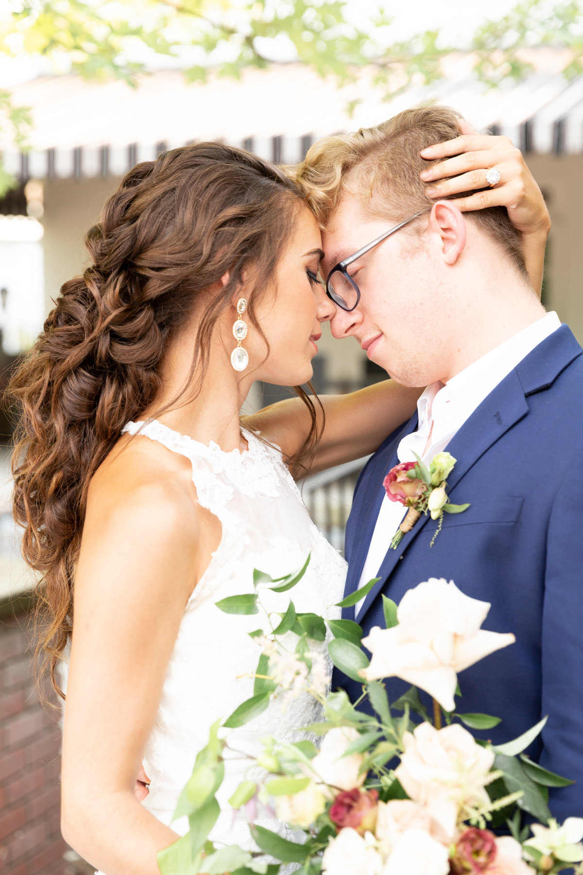 western ny bride and groom touch foreheads with eyes closed