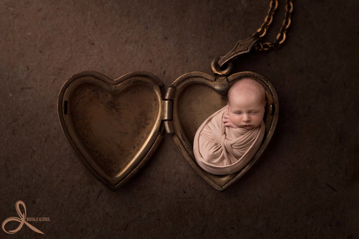 Baby boy in a heart locket