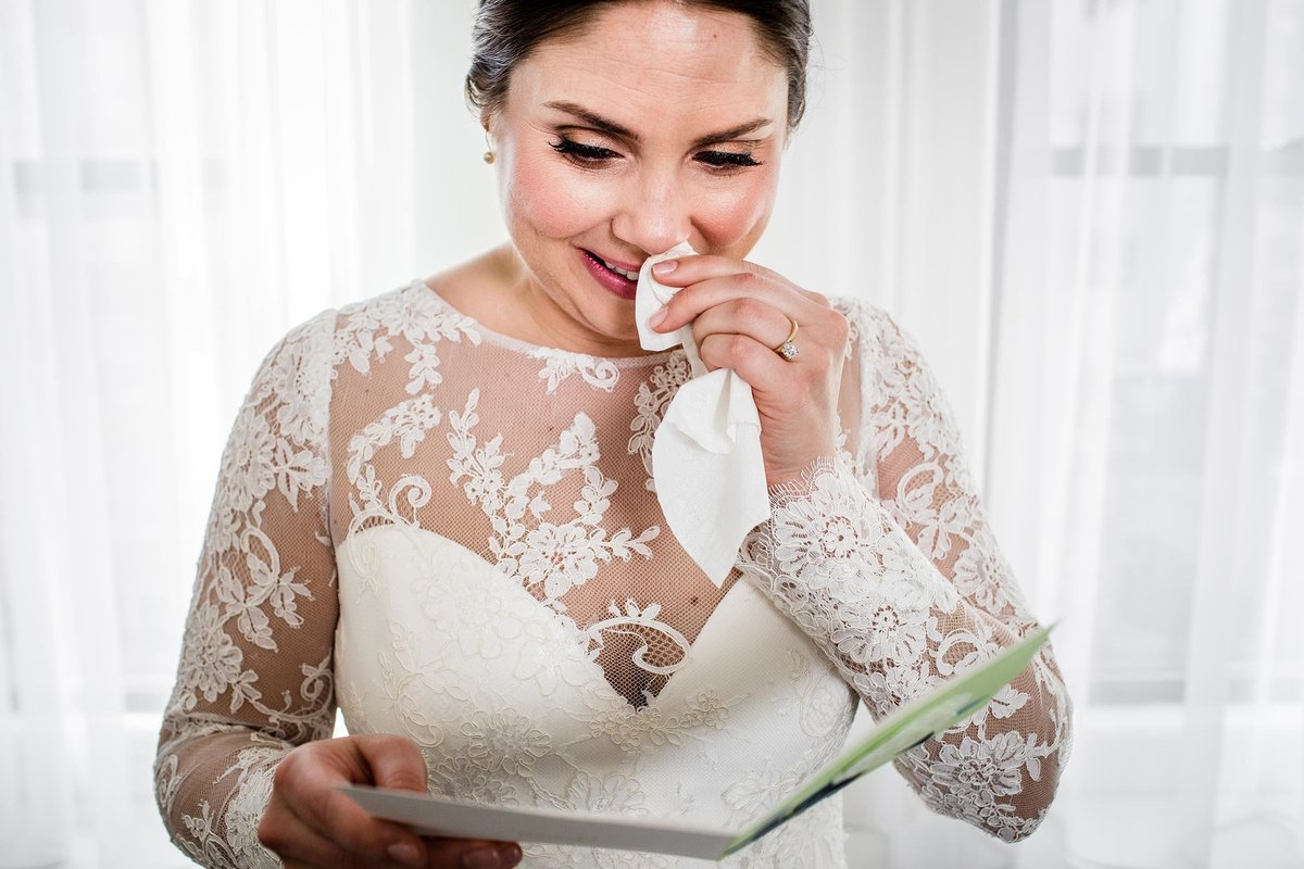 Bride reacts to a letter from her groom before her Boarding House wedding.
